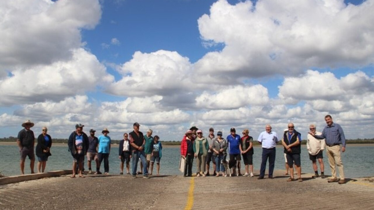 Members of the Woodgate community and Stephen Bennett meet to talk about issues at the boat ramp.