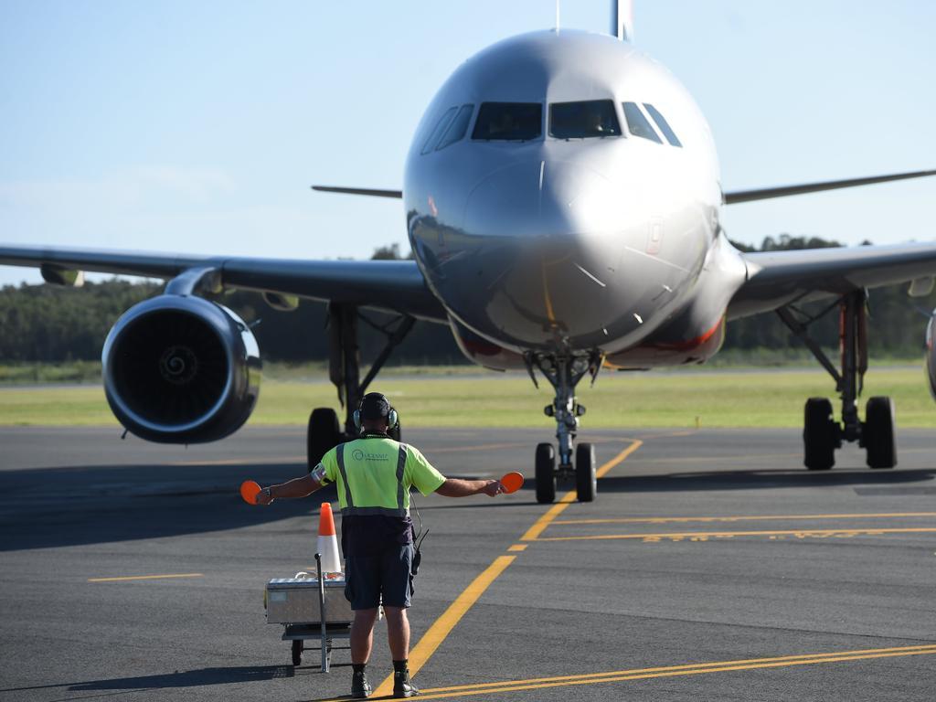 A plane lands at Ballina Airport.