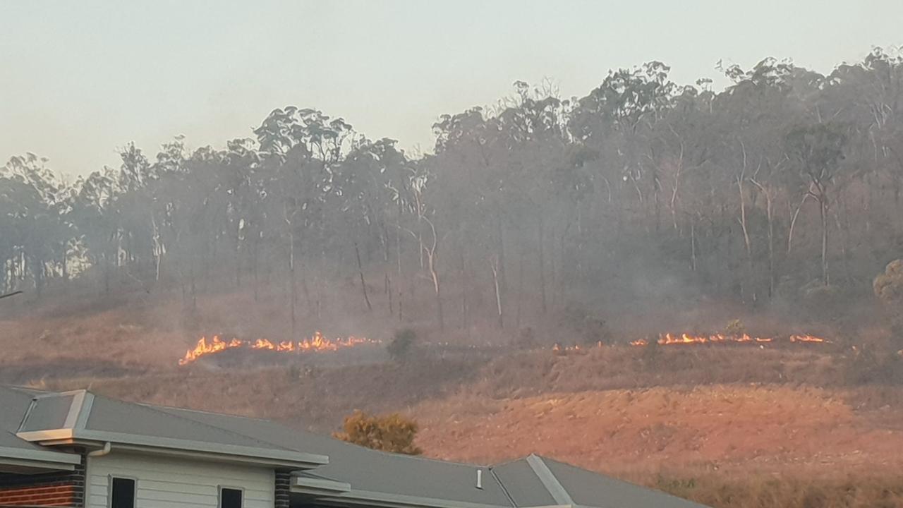 Back-burning behind Norman Gardens homes.