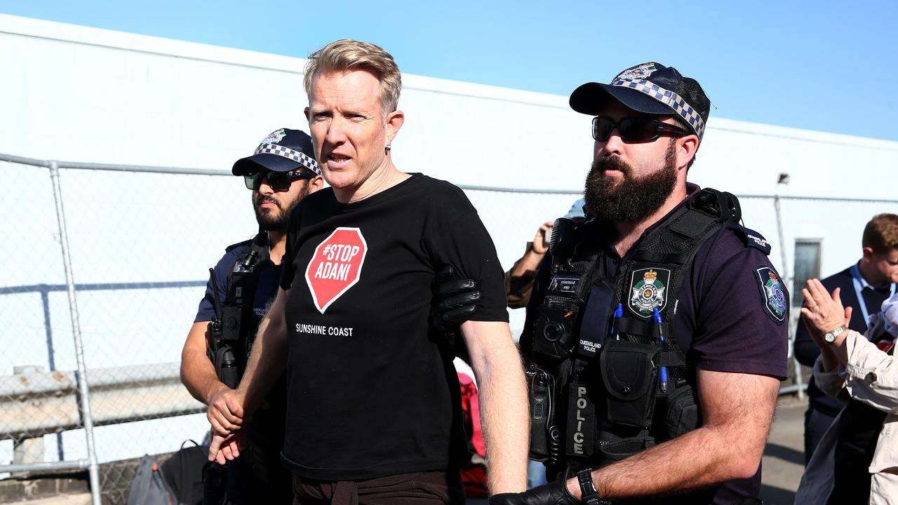 LEGAL ACTION: Adani is taking legal action against Anti Adani protester Ben Pennings. In this photograph he was involved in protesting at the Meales Concrete Pumping driveway at Windsor and was arrested by Police. Pics Adam Head