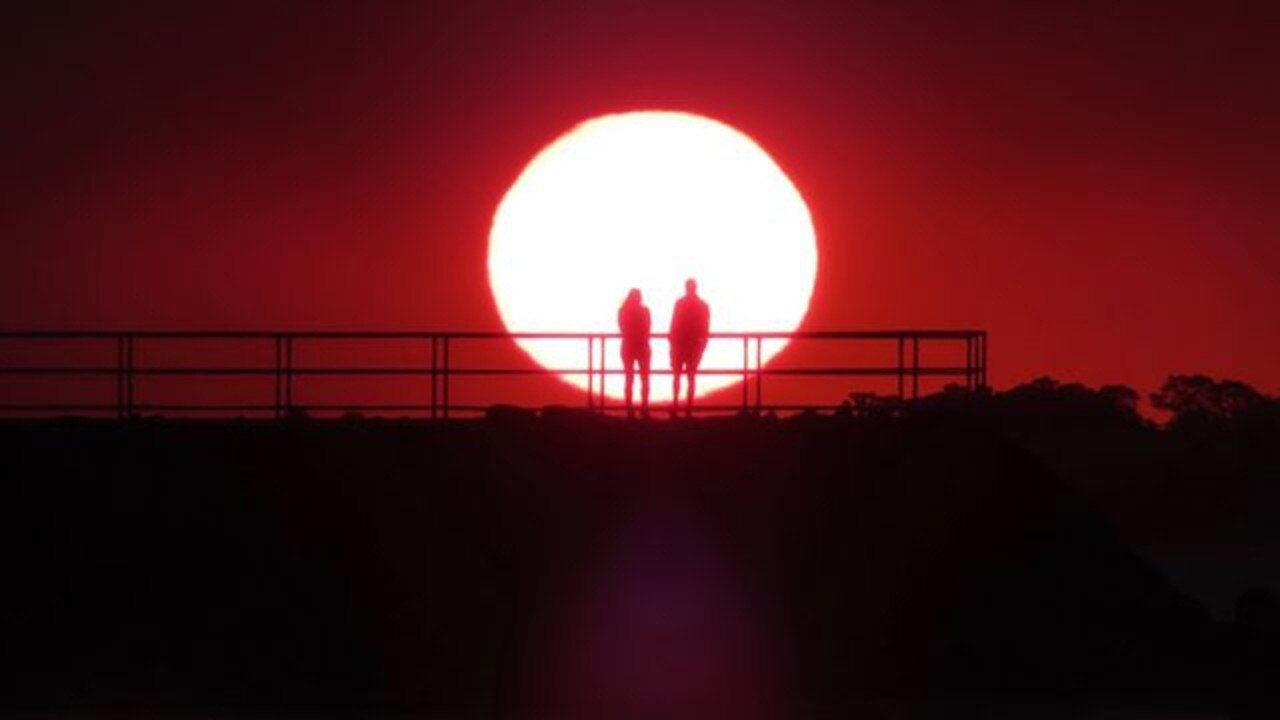 SUNSET COUPLE: The photo Peter Giesemann took while visiting Hervey Bay, he is looking for the couple in the photo. Photo: Contributed/ Peter Giesemann.
