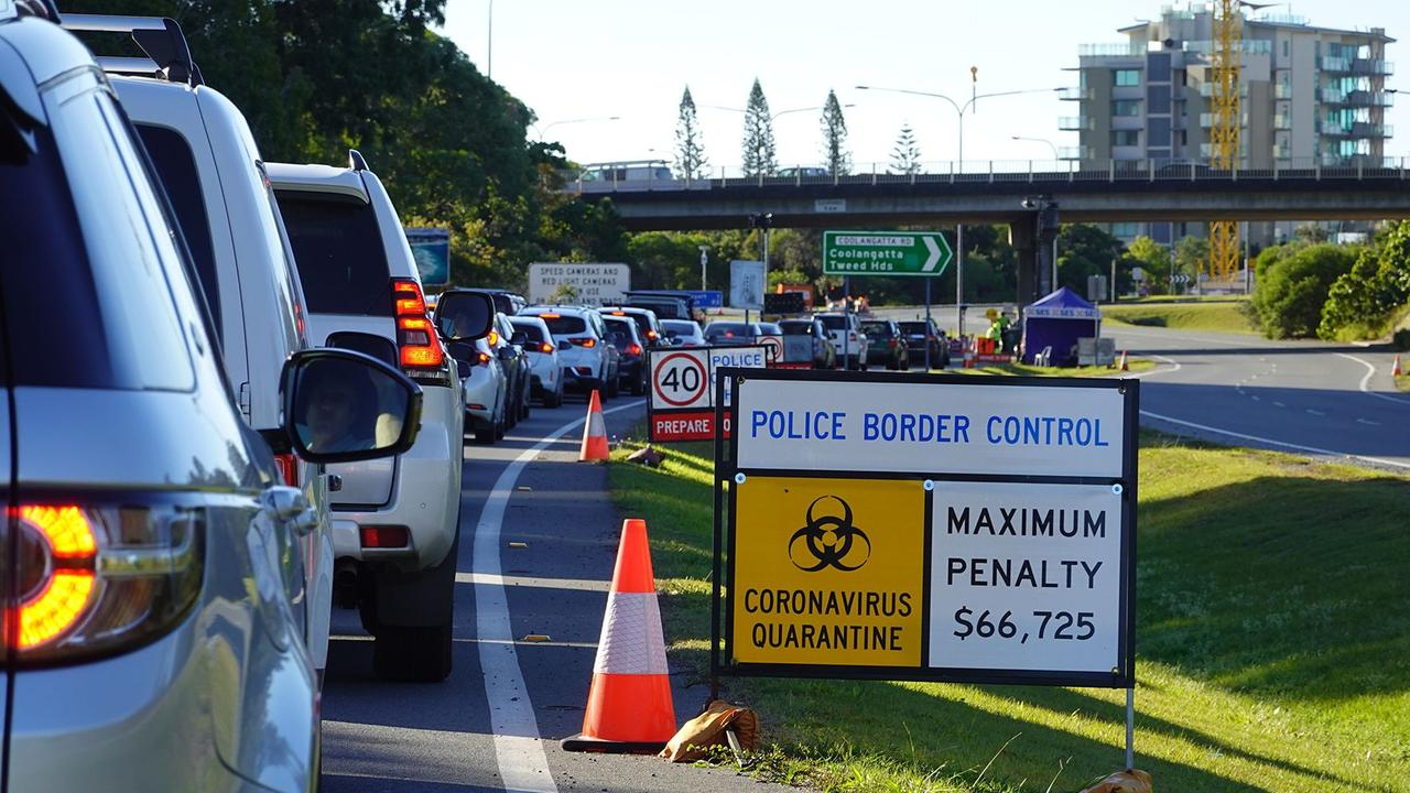Queensland police have charged two people after finding guns and drugs in a car attempting to cross a border checkpoint.