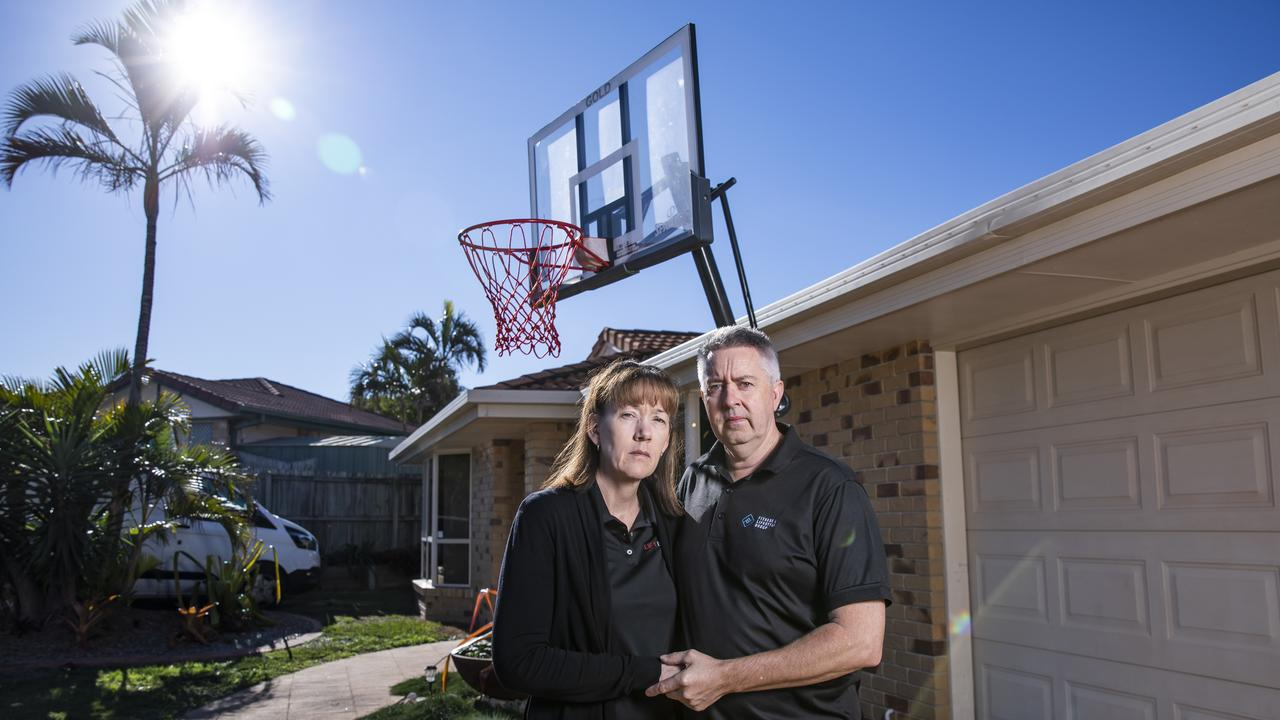 Peter and Fiona Waterson lost their son Jonah to suicide this year. Jonah's basketball hoop is in the background. Picture: Mark Cranitch
