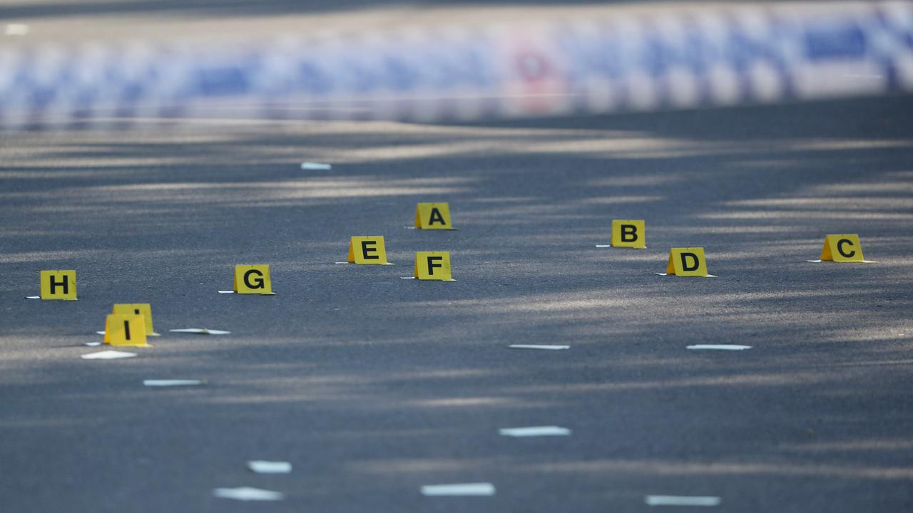 Evidence marked out at a police shooting at Upper Mount Gravatt. Picture: Peter Wallis