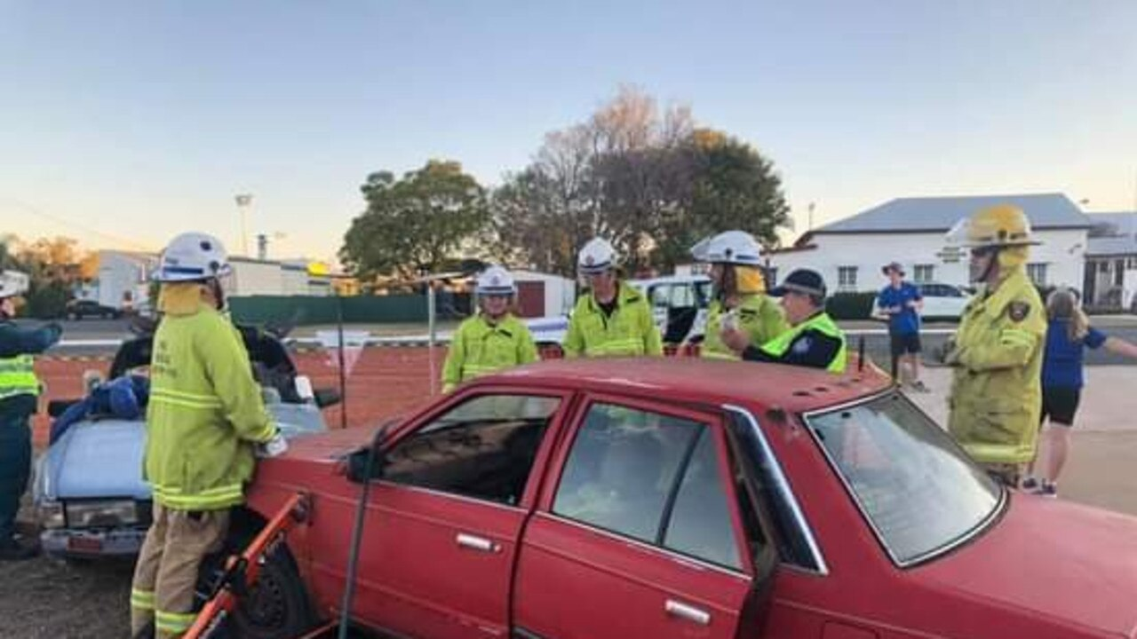 Emergency Service Workers provide an example of what is involved in a traffic incident in Mundubbera on Monday. (Picture: Contributed)