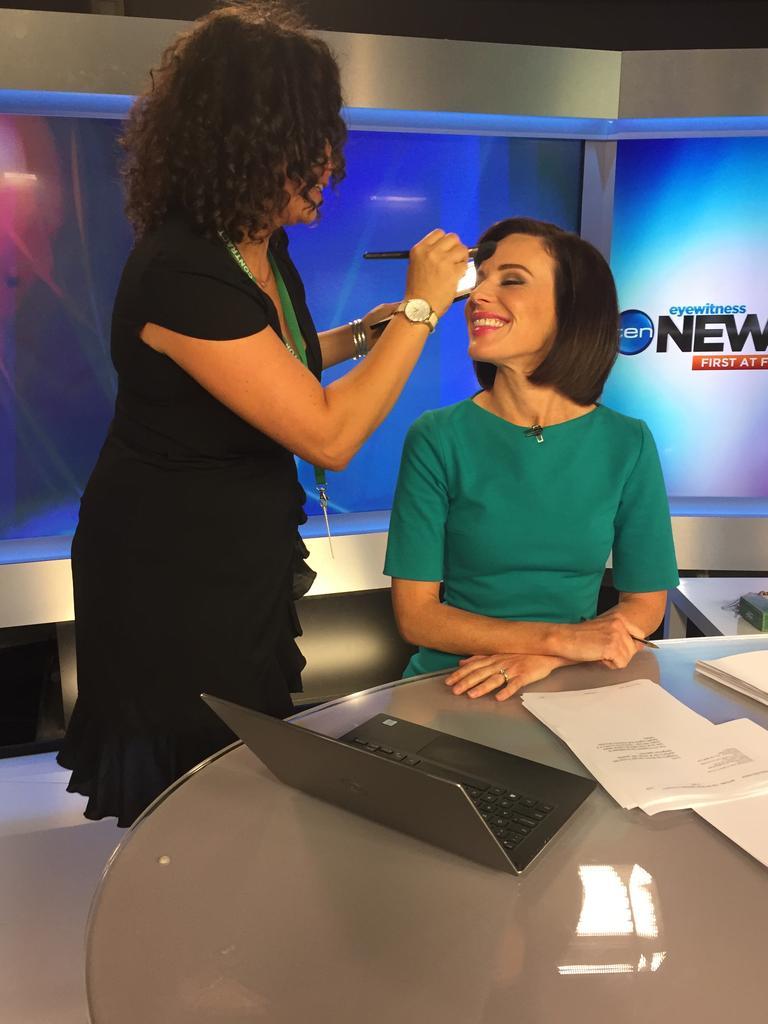 Venus Lee makes some slight adjustments to Channel 10 news reporter Natarsha Belling's make up.