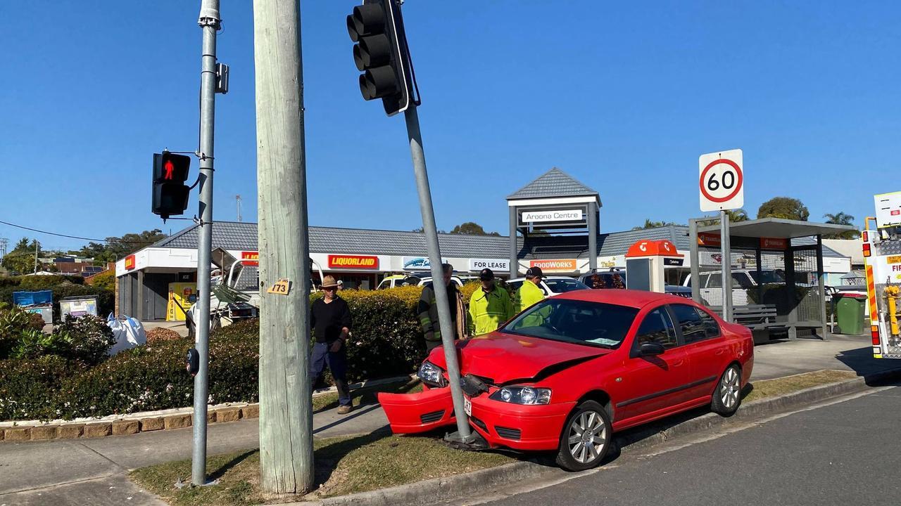 A car has crashed into a pole in Caloundra.