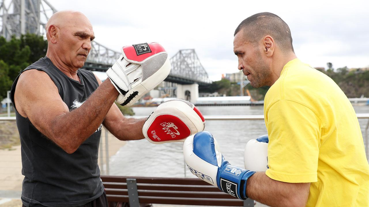 Tony Mundine, with son Anthony, trained at the Newtown gym. Picture: Peter Wallis