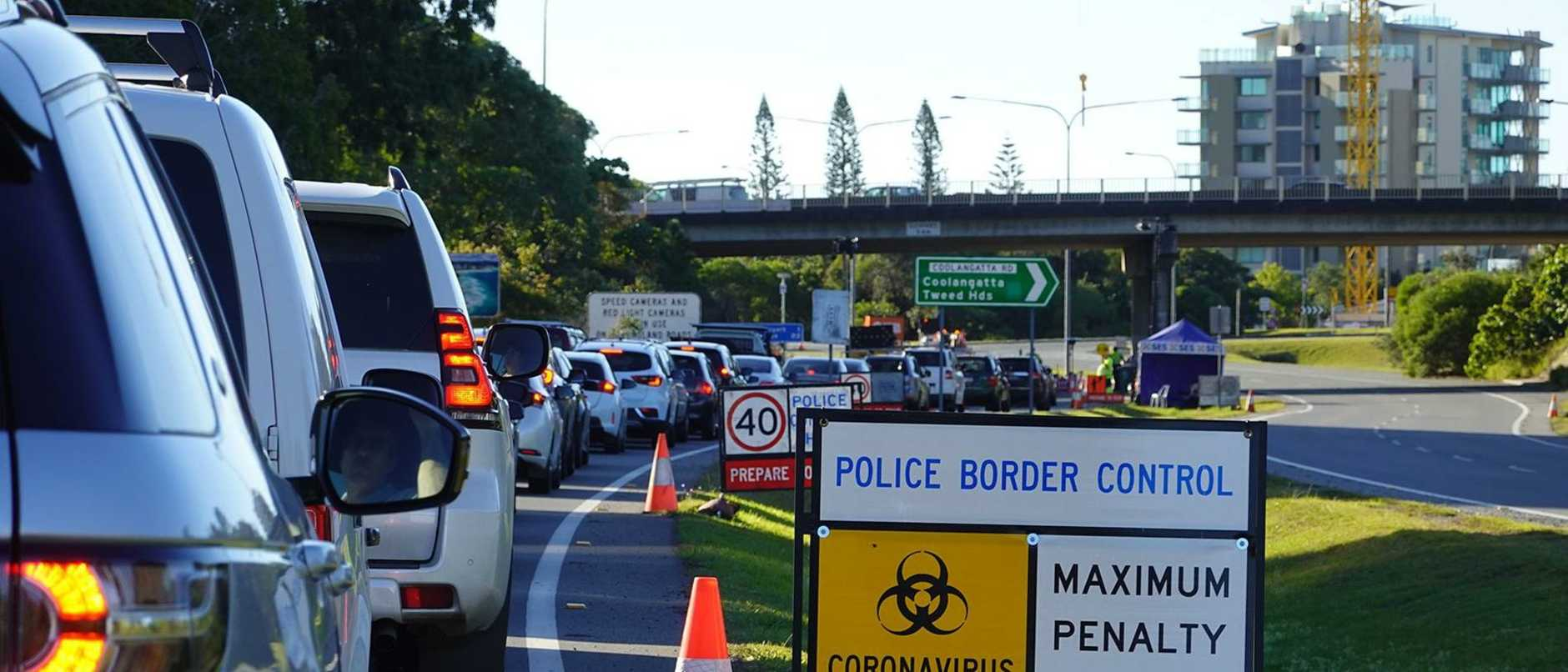Two people have been charged after border police found a stash of weapons and drugs in their vehicle.