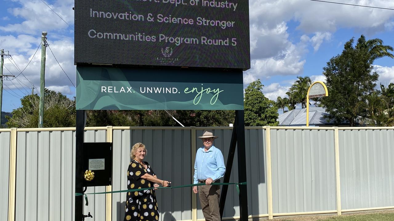 Capricornia MP Michelle and FSC Deputy Chairman Jeff Krause celebrate the scoreboard's unveiling.