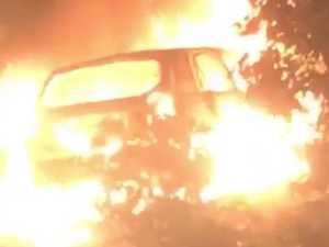 Driver makes lucky escape as car engulfed in flames