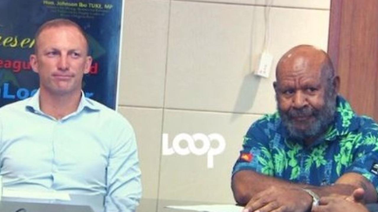 Darren Lockyer with Kainantu MP and Mining Minister Johnson Tuke in Port Moresby.