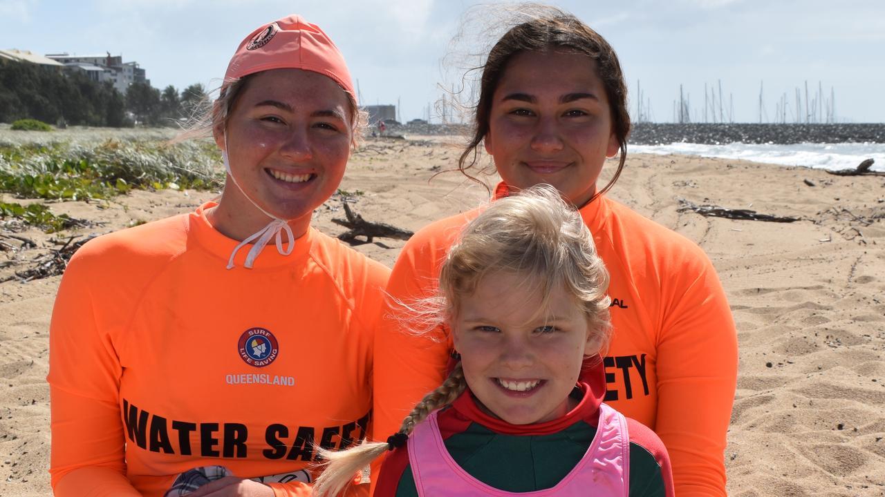 Mackay Surf Lifesaving Club members Keesha Close, Klara Close and Rhapsody Howat, 8, at the club's open day at Mackay Harbour, August 30, 2020. Picture: Heidi Petith