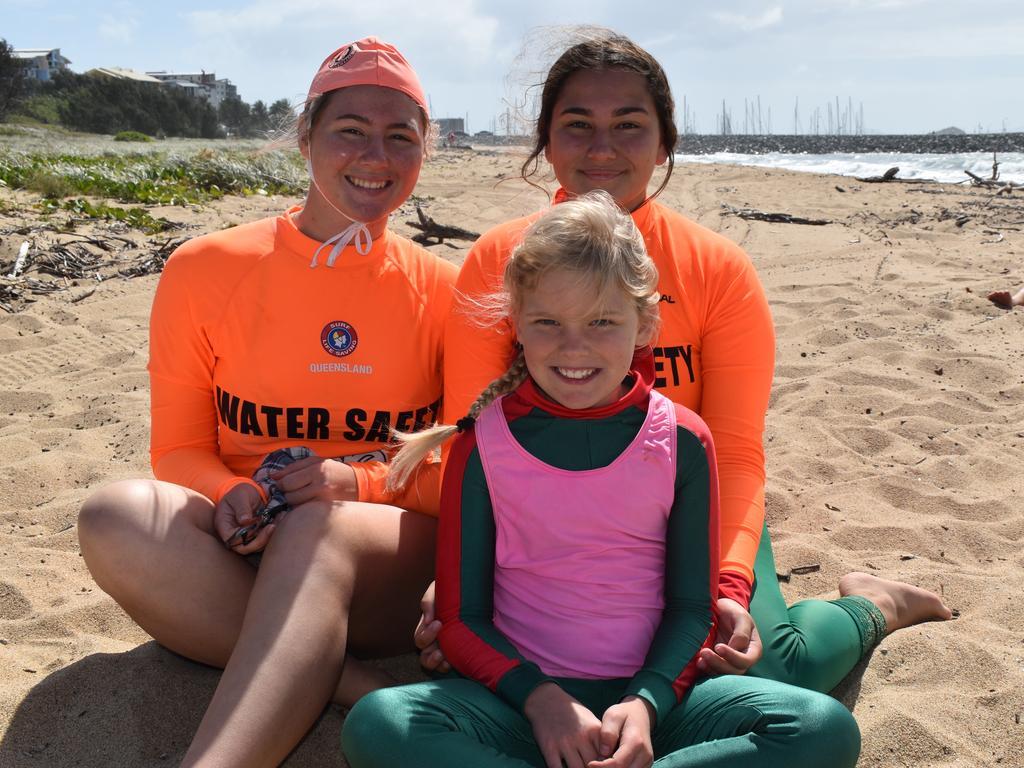 Mackay Surf Lifesaving Club members Keesha Close, Klara Close and Rhapsody Howat, 8, at the club's open day at Mackay Harbour. Picture: Heidi Petith