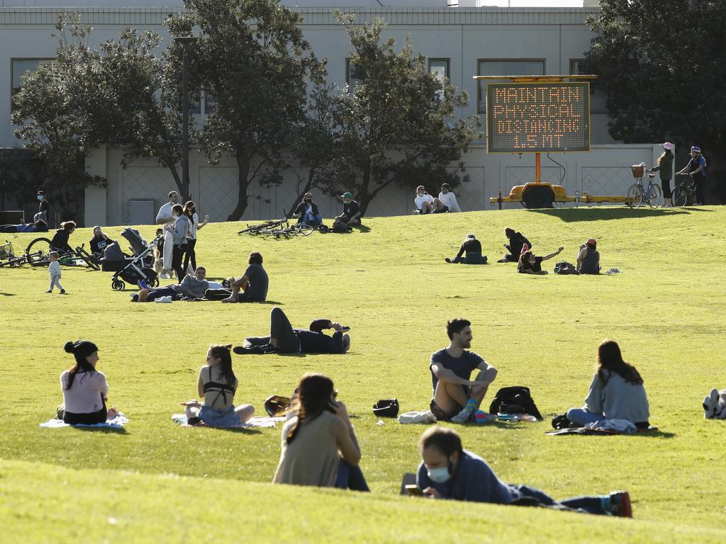 Melburnians enjoy the sun, with many going mask-free, in St Kilda. Picture: NCA NewsWire / Daniel Pockett