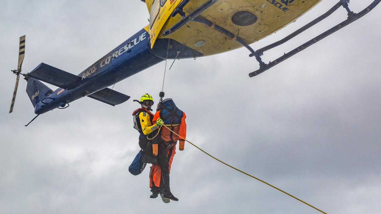 During a joint exercise with Volunteer Marine Rescue, RACQ CQ Rescue's Ben McCauley was winched out of a chopper and onto the VMR boat to retrieve a dummy. Picture: Emma Murray