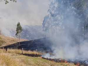 Brigades pitch in to battle out-of-control grass fire