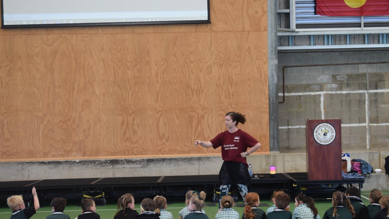 Queensland Ballet education manager Martha Godber teaching Kin Kora State School Year 1 students as part of their in-school workshops