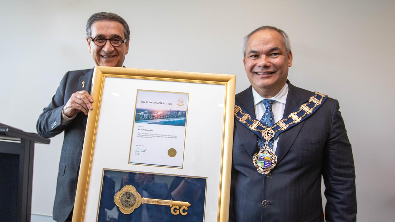 Sunland chairman Soheil Abedian receives the keys to the city from Gold Coast Mayor Tom Tate.