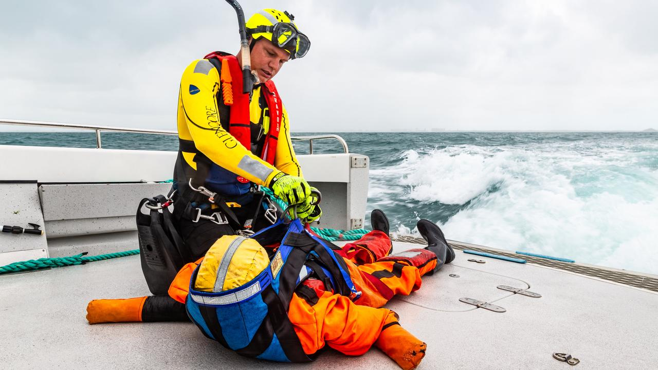 During the joint exercise with Volunteer Marine Rescue, RACQ CQ Rescue's Ben McCauley was winched out of their chopper and onto the VMR boat to retrieve a dummy.
