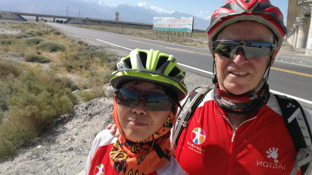 Jerry Grey and his wife Ann Liang Yuhua on a charity bike ride last year.