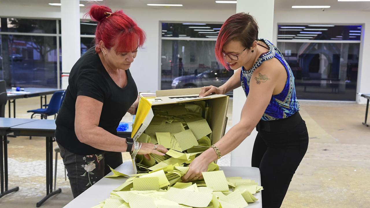 Nina Cappola and Kayla Chamberlain empty the ballot box prior to counting.