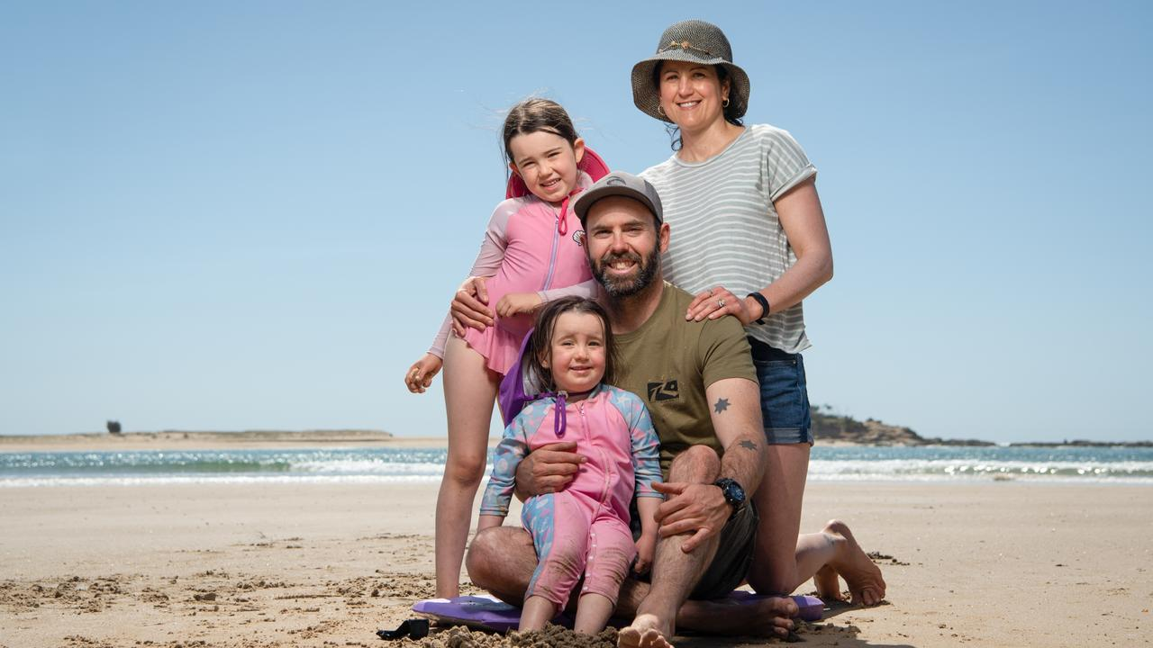 Regan and Jana Diehm with daughters Lexie, 6, and Zahra, 4, on the banks of the Maroochy River. Picture: Brad Fleet