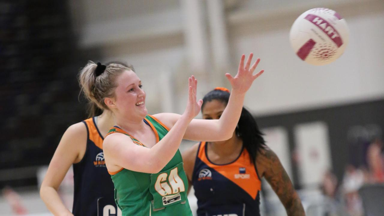 Ipswich Flyers netballer Kirsty Brennan gets heavily involved in play for her team.