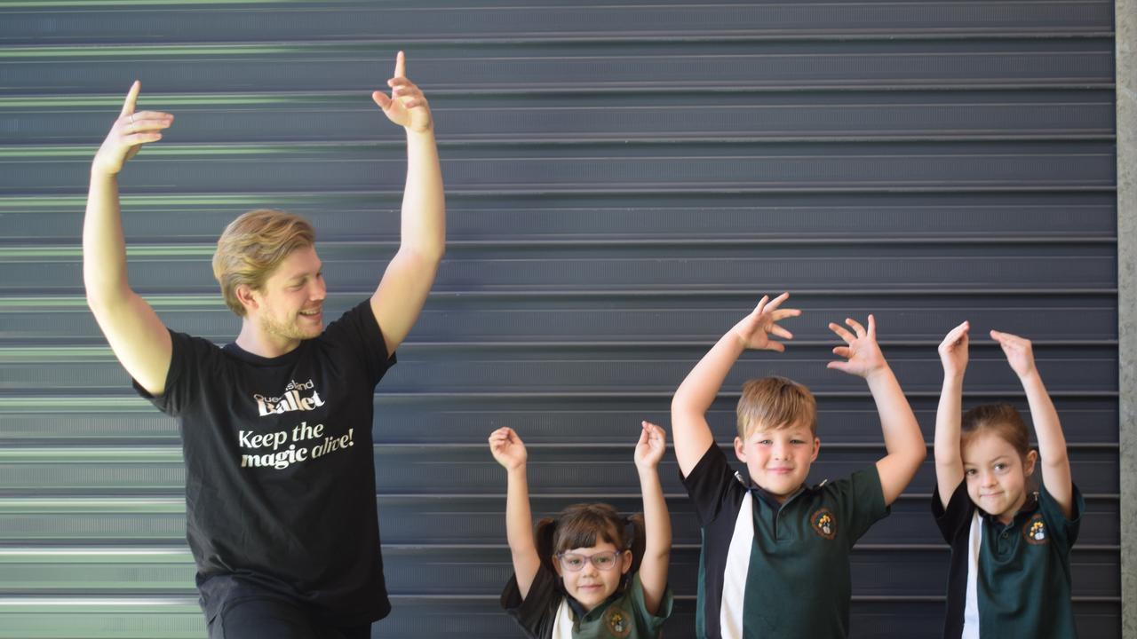Brisbane Ballerino Rian Thompson and Kin Kora State School year 1 students Emily, Ryder and Jasmine