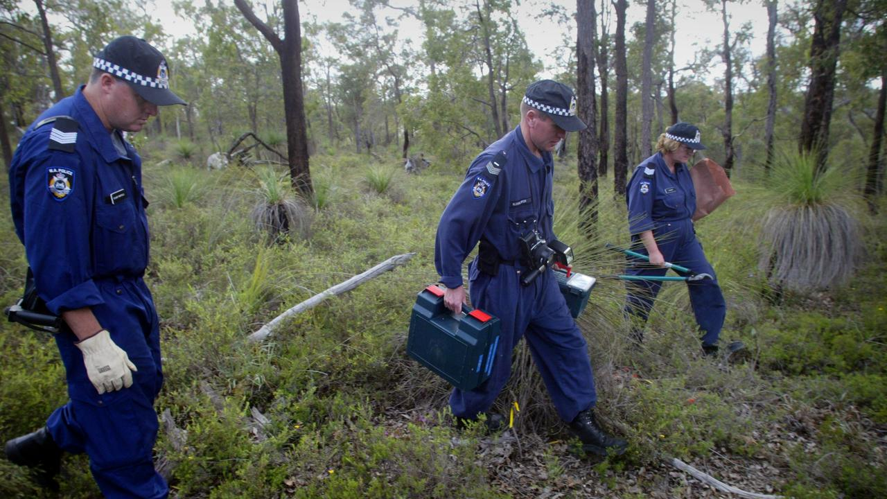 Western Australian forensic police officers gather evidence in bushland at Hovea in Perth where a body was found in 2004. Picture: Ross Swanborough