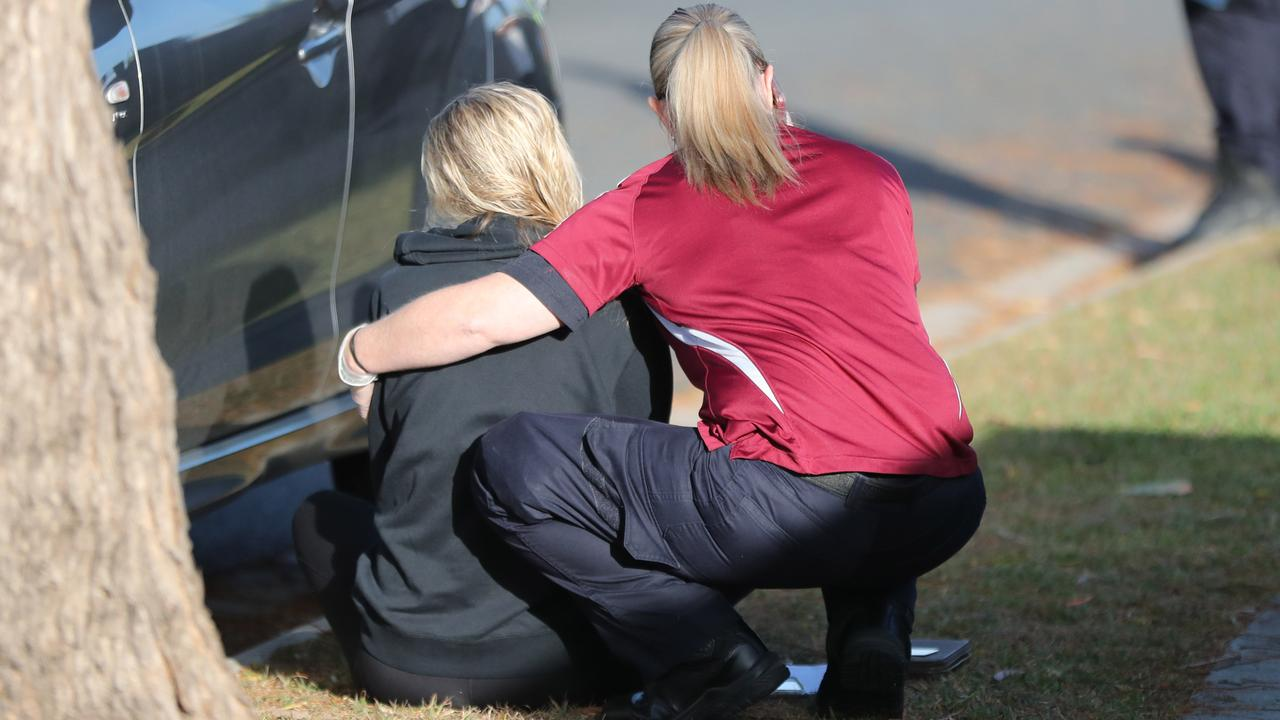 A woman is comforted at the scene of the incident. Picture: Peter Wallis