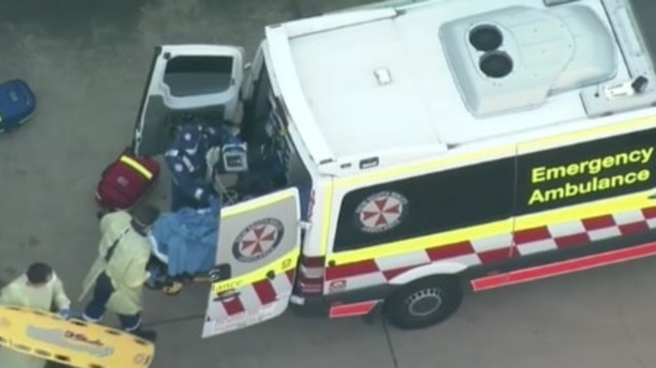 A man has been rushed to hospital with burns to his torso and arms after a workplace accident in Ingleburn, Sydney. Picture: 9 News