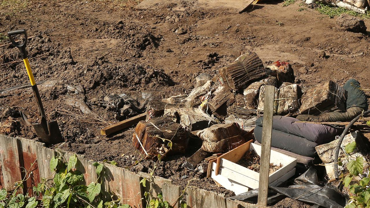 Old catalogues and furniture can be seen near the fence line where the resident made the grisly discovery of human bones. Picture: Alison Wynd