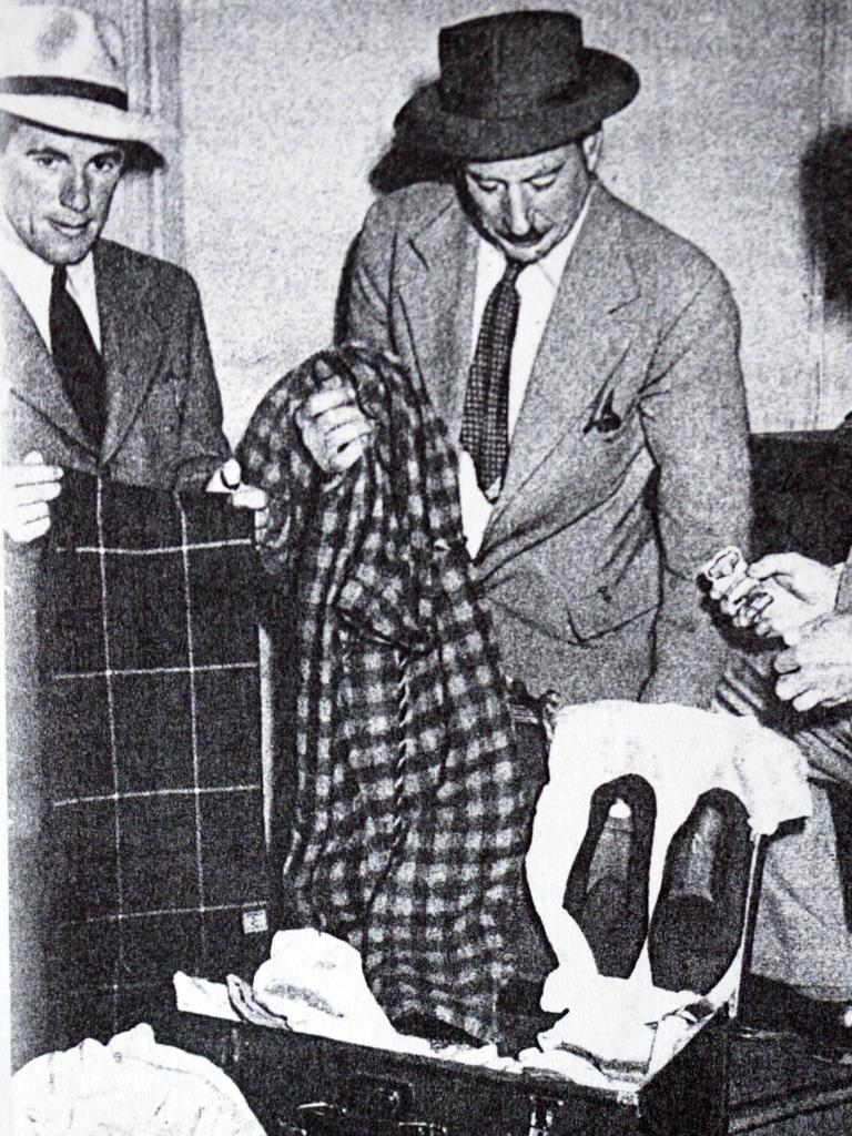 Detectives examine a suitcase recovered at Adelaide Railway Station.