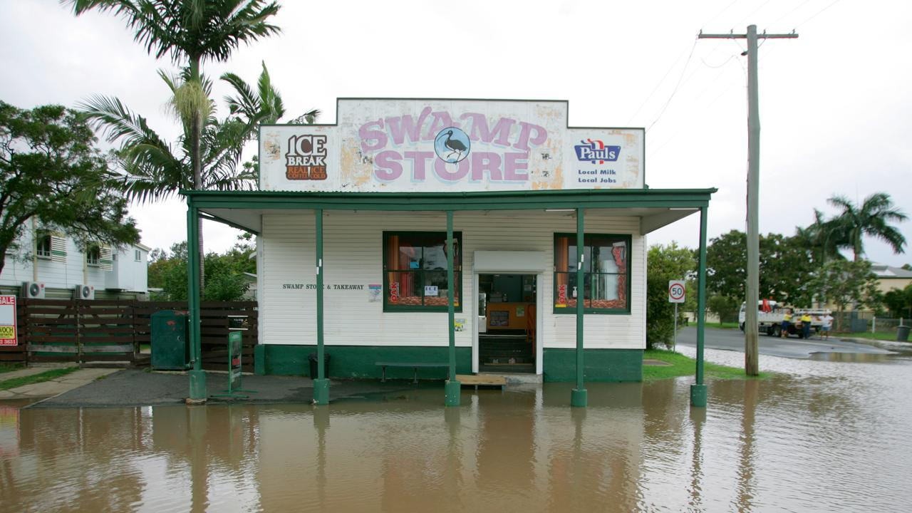 The Swamp Store is still open for business as the Fitzroy River rises past 8.2 to an estimated 8.5 peak at Rockhampton in 2013. Photo: Chris Ison / The Morning Bulletin