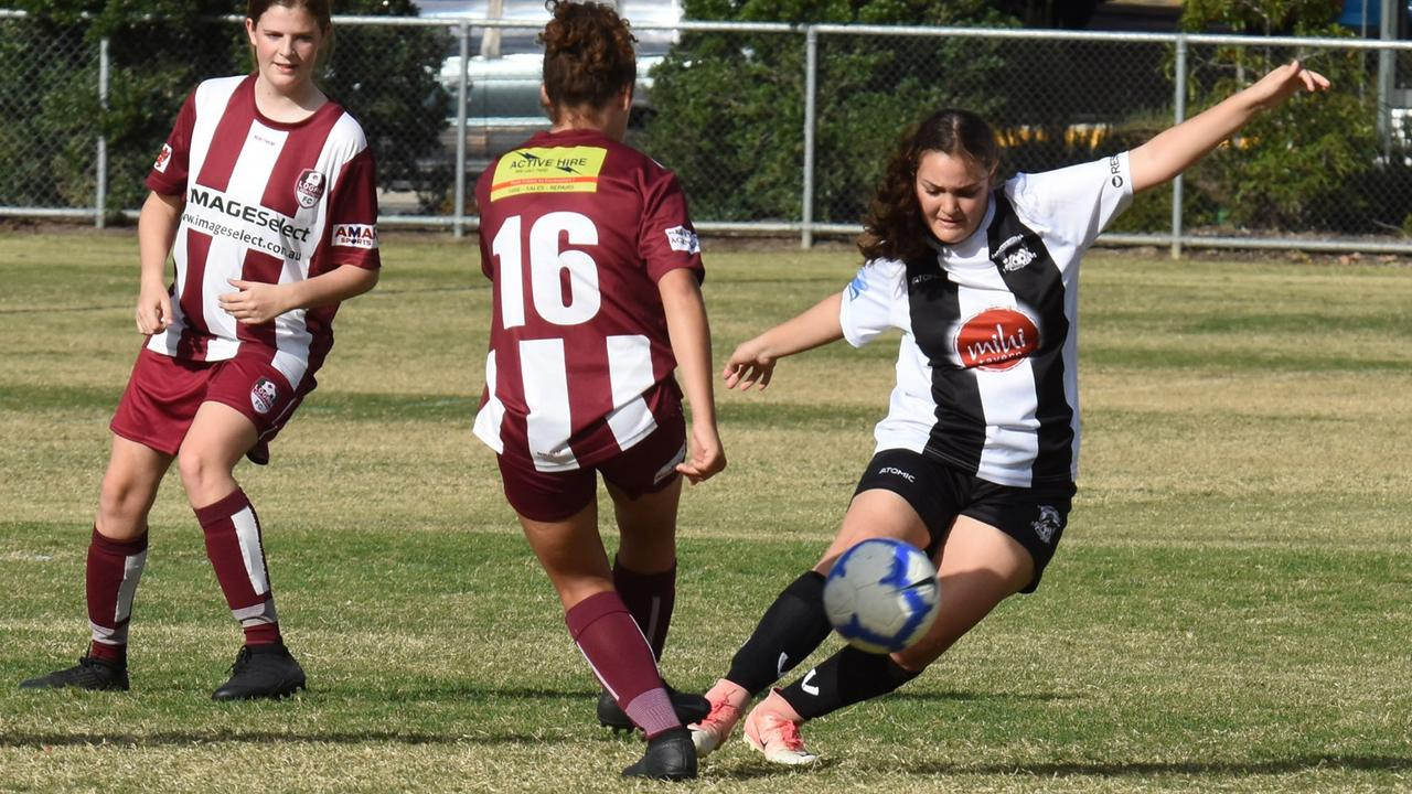 An Ipswich City Bulls under-18 player works hard to control the ball during her team's 3-2 loss to Logan Lightning at Sutton Park. Picture: Gary Reid
