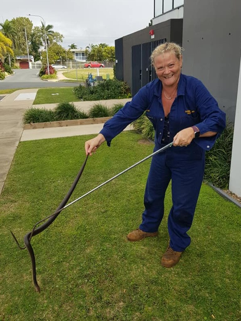 Mackay and Sarina Snake Removal owner Heather Lampe with a large eastern brown snake. She said two male eastern browns were in combat in the middle of the road at Hay Point last week.