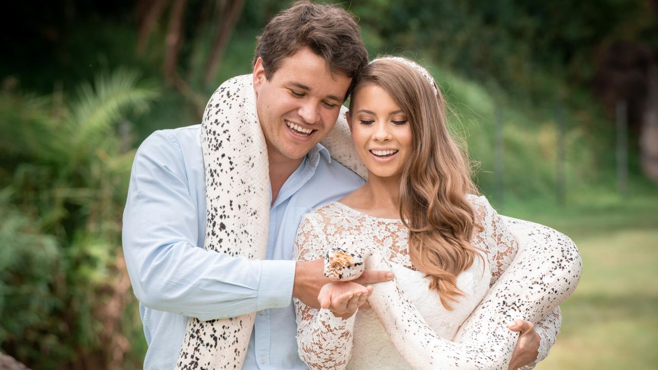 Chandler Powell and Bindi Irwin on their wedding day with a python. Picture: Kate Berry
