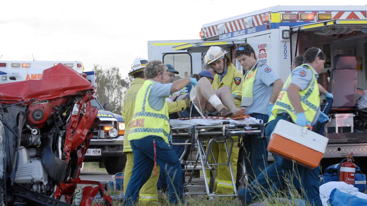 Paramedics work at the scene of a crash near Tiaro in 2006. PicJohnWilson