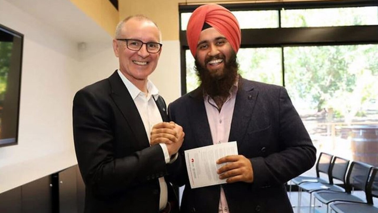 Former Labor candidate Sim Singh-Mahli with then-premier Jay Weatherill before the last state election.