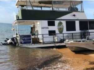 Stranded boatie still living on grounded houseboat