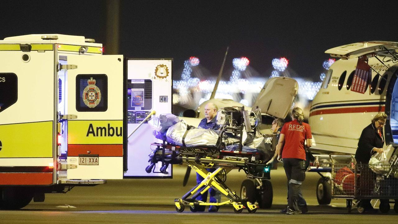 An injured person from an explosion at Grosvenor coal mine at Moranbah pictured arriving at the Royal Flying Doctors Service, Brisbane on May 6. This is the second flights to arrive after an explosion at the mine left five people seriously injured.