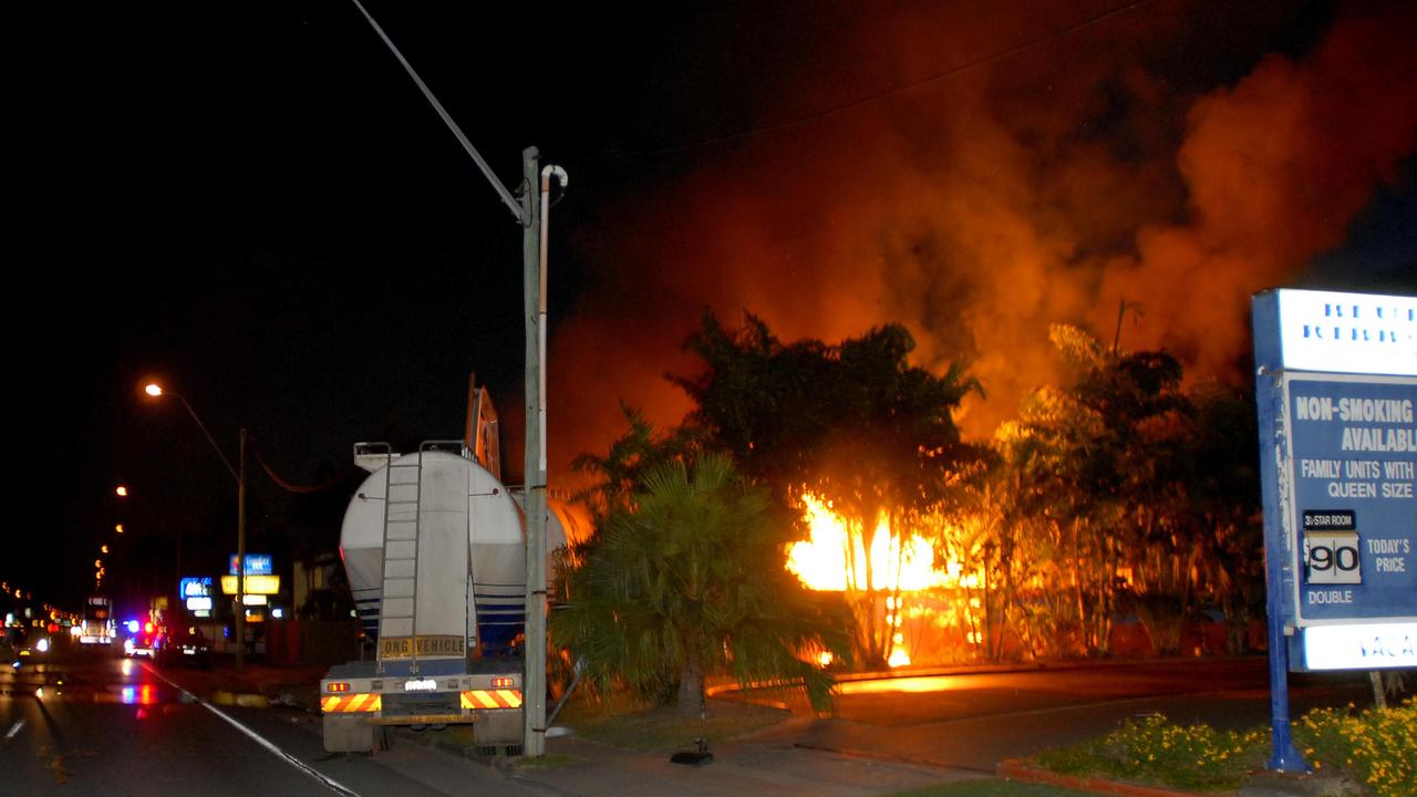 Flames leap metres above the Country Plaza Motor Inn on Nebo Road after a truck crashed into gas bottles in 2009. Picture: Amanda Balmer