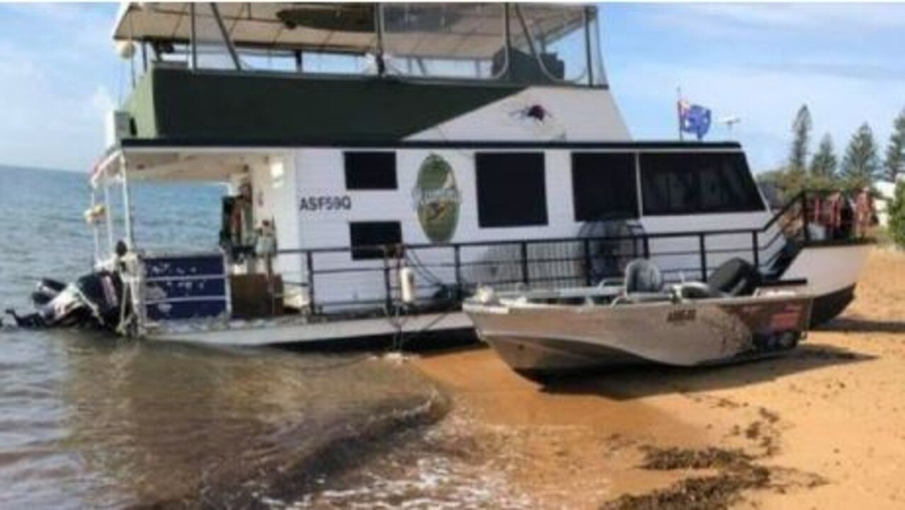 He's been sleeping on an angle and eating tinned dinners for nearly a month but a boatie whose houseboat ran aground has been given a leg up by locals.