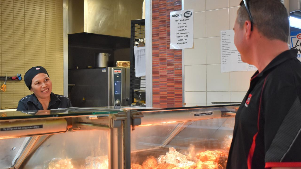 Perry's IGA deli manager Elena Williamson serving lunch to Stew Hughes. Picture: Heidi Petith