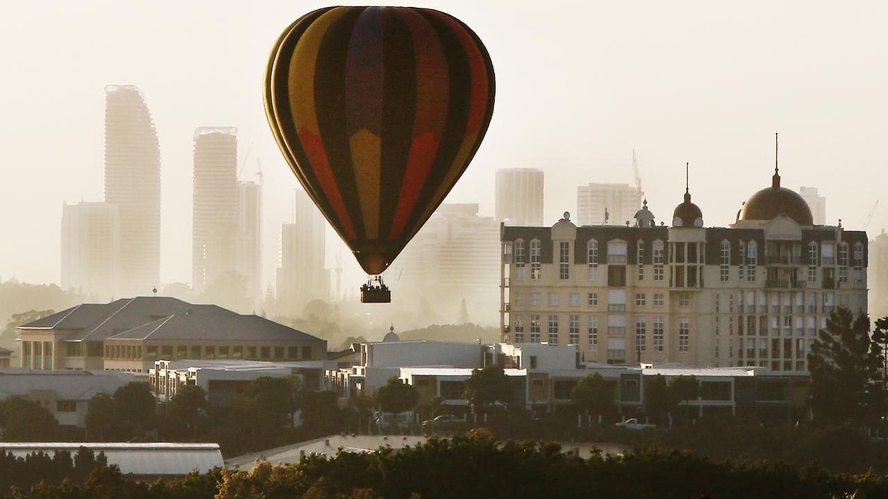 A balloon comes into land at Emerald Lakes, avoiding the spires on the French Quarter buildings, on Thursday morning. Once a common sight in the area, Balloons with their baskets full of tourists are now something of a rarity. Picture Glenn Hampson