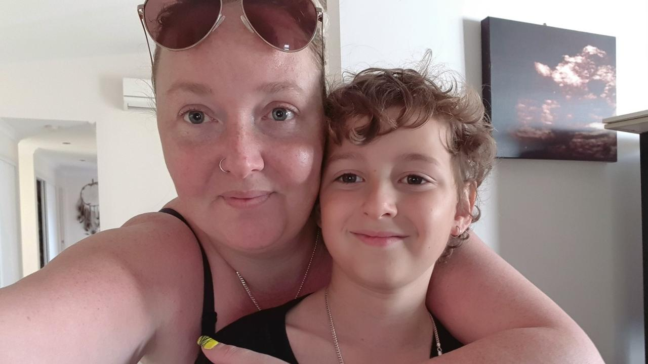 Kasey Harris with her nine-year-old son Liam, who has been bullied on the local school bus.