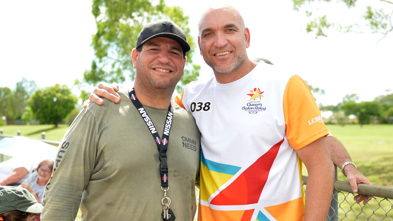 Gorden Tallis with Carl Webb in Townsville during the baton realy of the 2018 Commonwealth Games. Picture: Alix Sweeney