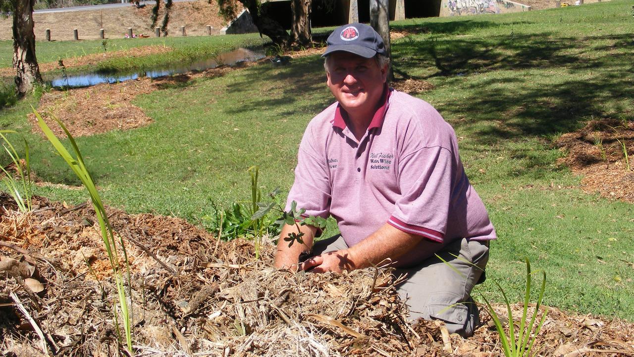 Neil Fisher mulching a new garden.
