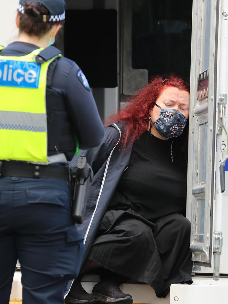 A woman is taken away in a divvy van. Picture: Alex Coppel